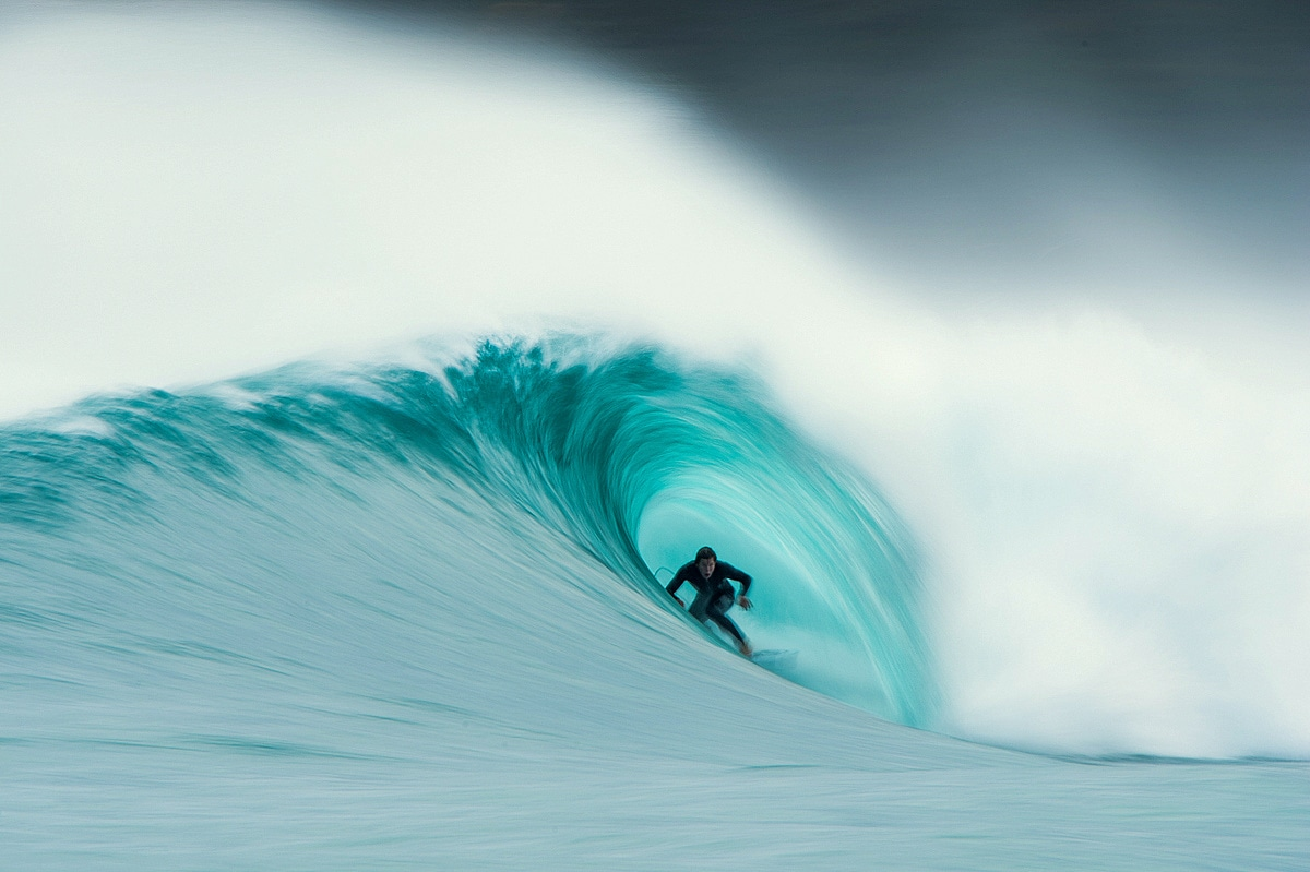 Surfer Riding the Barrel of a Wave