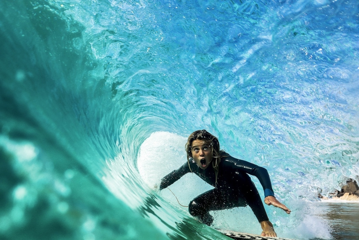 Young Surfer in the Barrel of a Wave