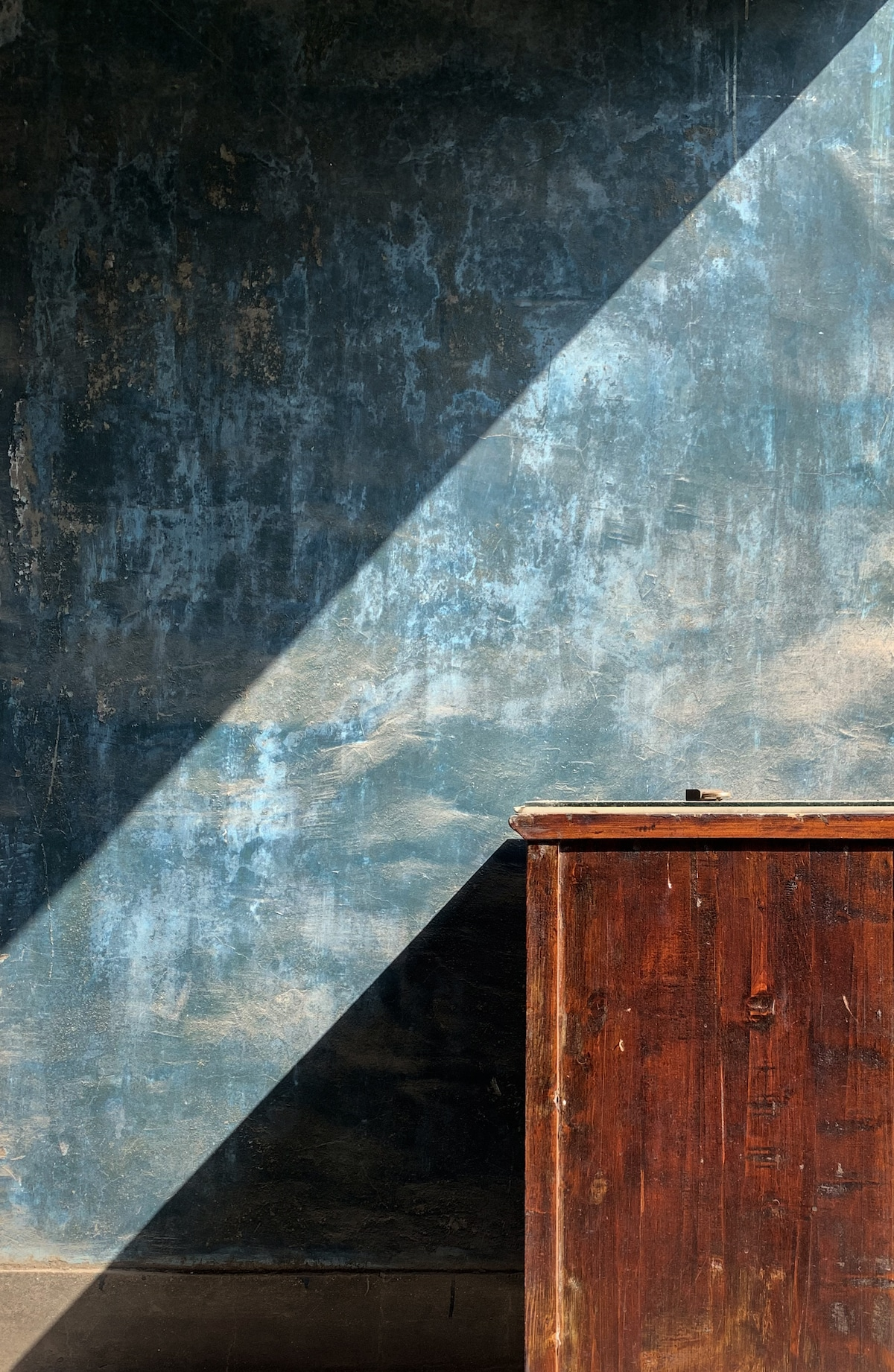 Dramatic Shadow Against Blue Wall