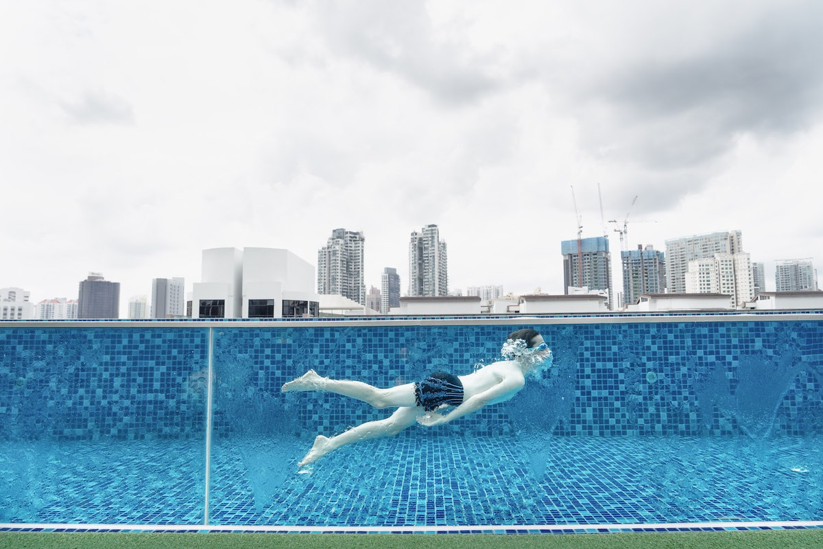 Person Swimming in a Roof Pool in Singapore