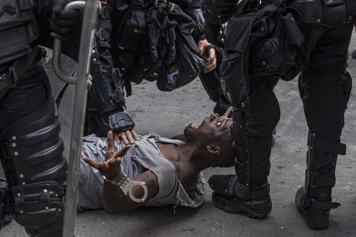 Protester in Colombia Being Confronted by the Police