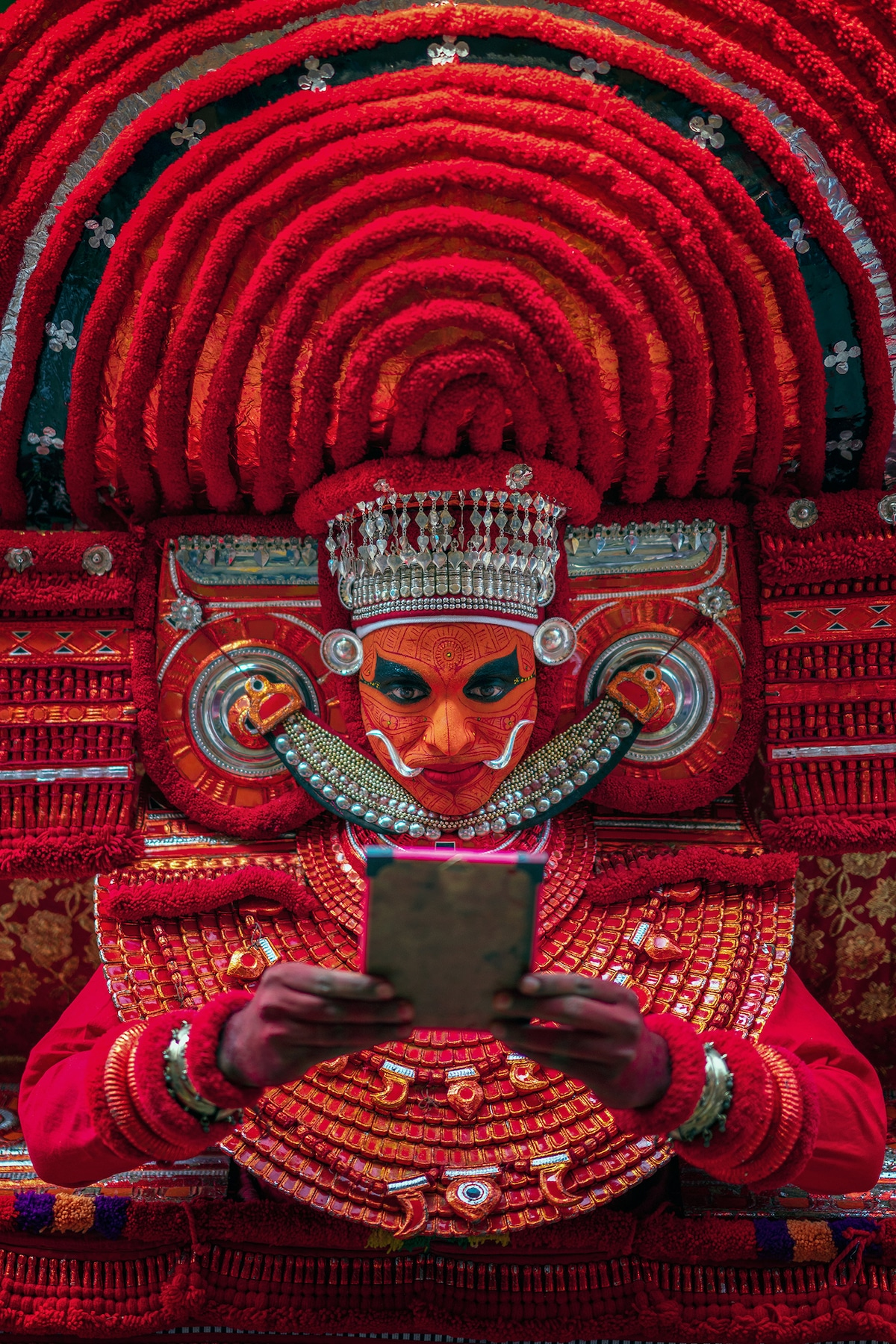 Man Dressed to Perform Theyyam Ritual in the in the north of Kerala, India