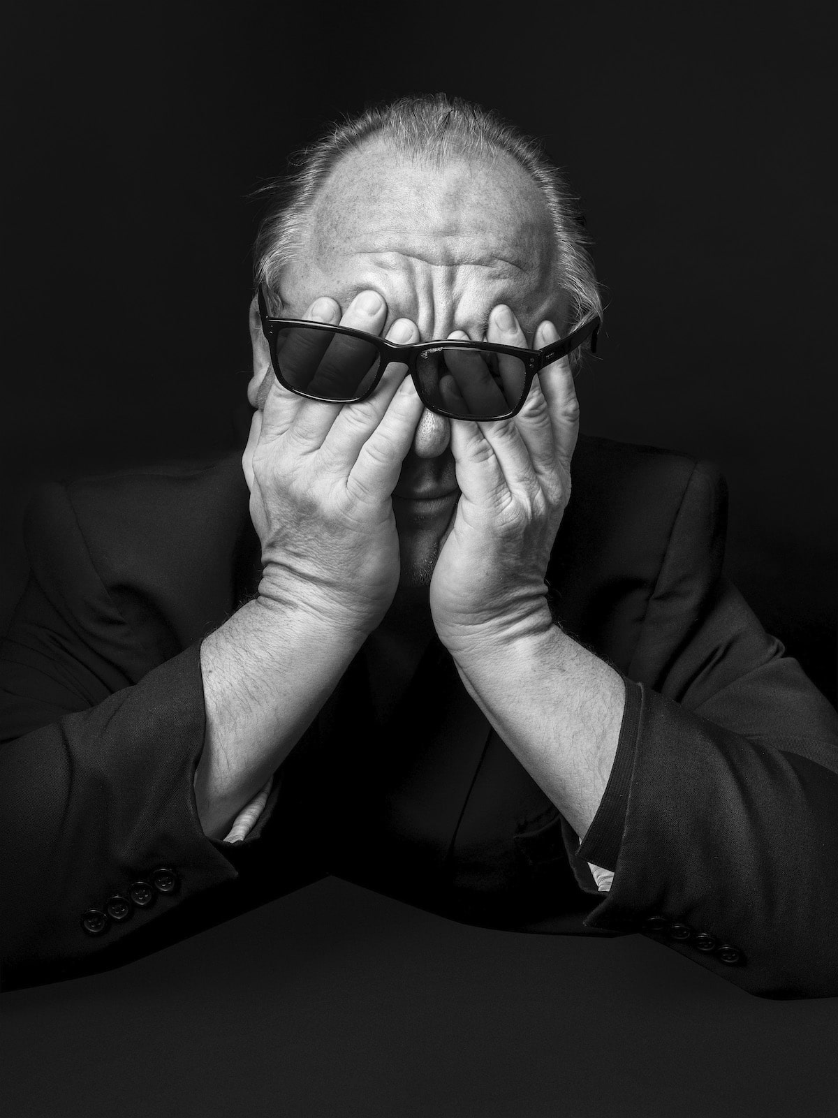 Portrait of Black Francis Covering His Eyes