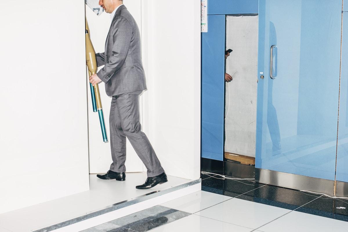 Businessman locks away a pair of anti-tank grenade launchers at IDEX