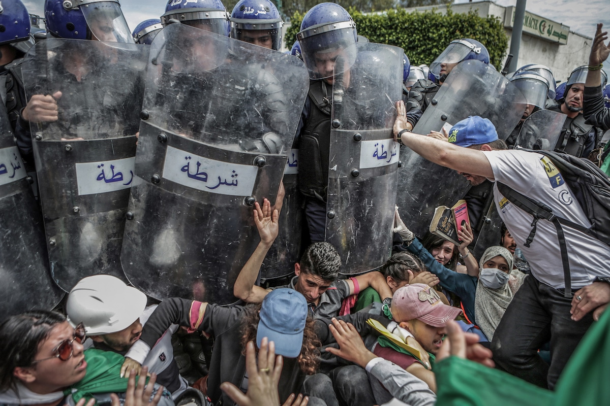 Algerian Protesters Scuffling with the Police