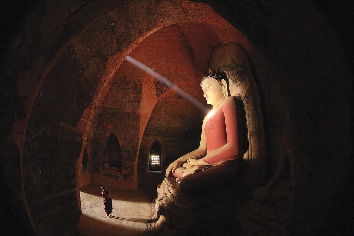 Light Streaming Through Temple with a Buddha Statue