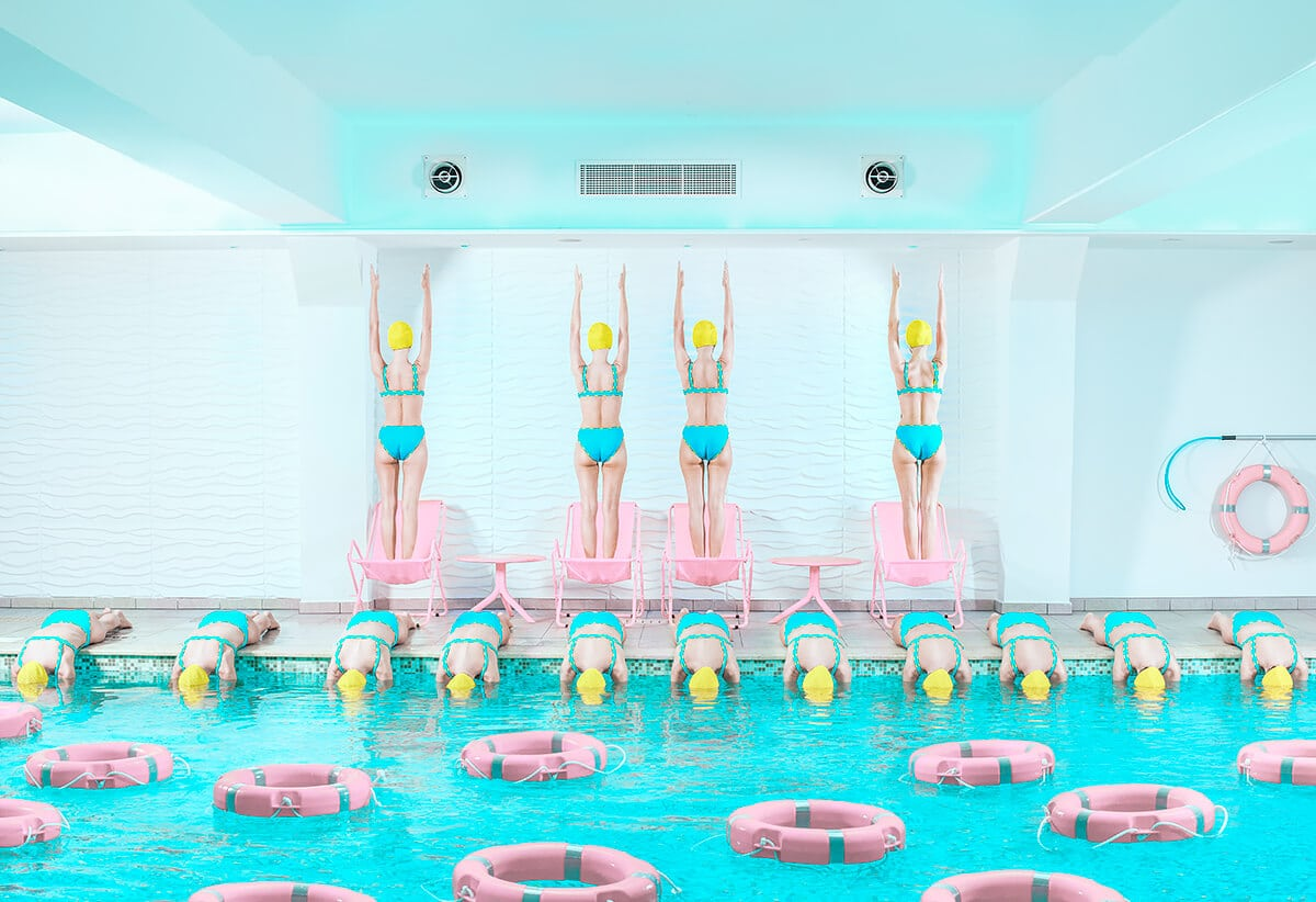 Colorful Photo of Swimmers in Pastel Bathing Suits