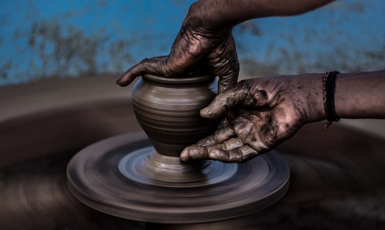 Potter Turning a Vase on a Potter's Wheel