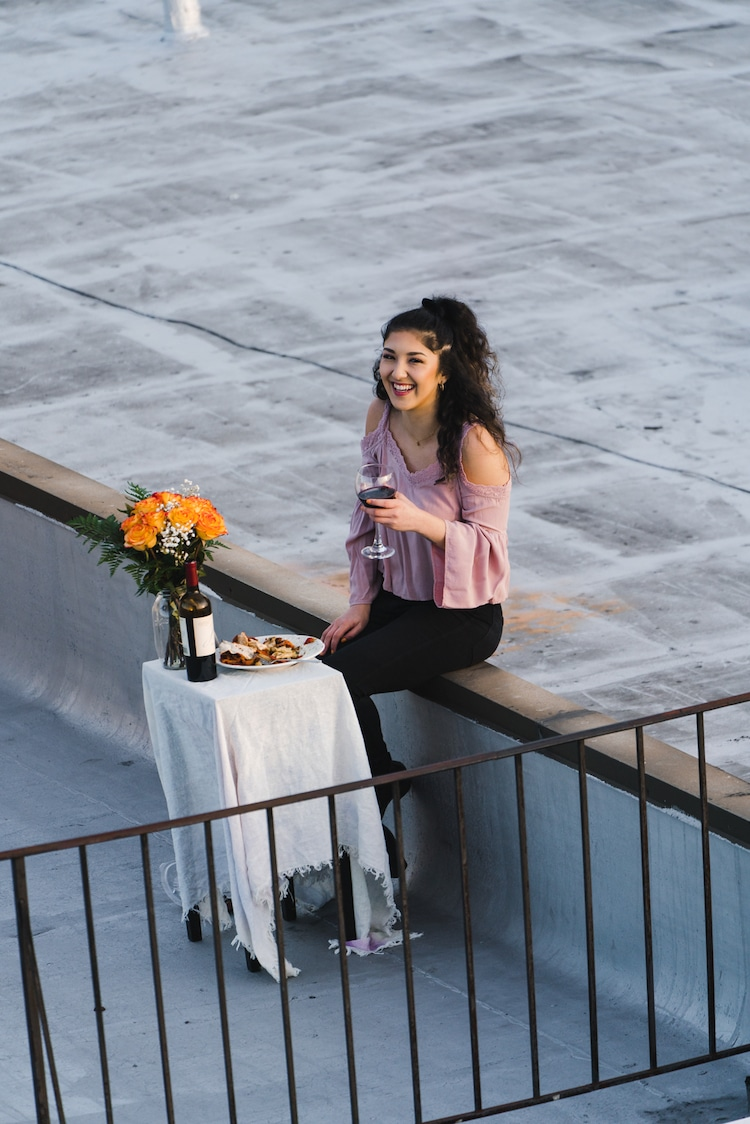 Woman Dining on Her Roof