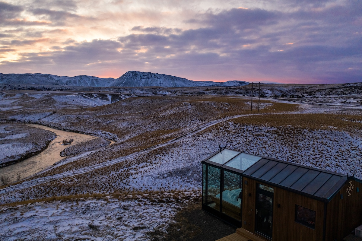 Glass Cabin in Icelandic Landscape