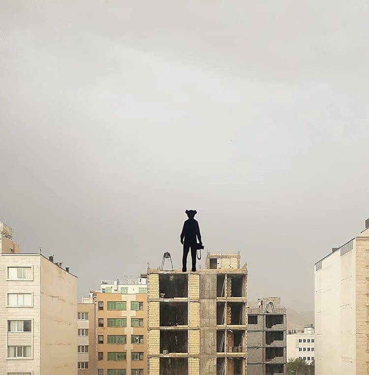 Painted Silhouette of Person Standing on the Roof of a Building