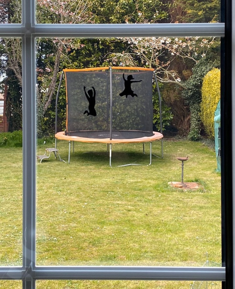 Painted Silhouette of Kids Jumping on a Trampoline