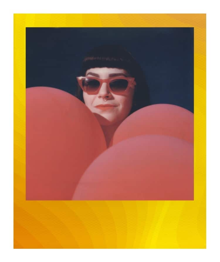 Polaroid of Girl with Sunglasses Surrounded by Balloons