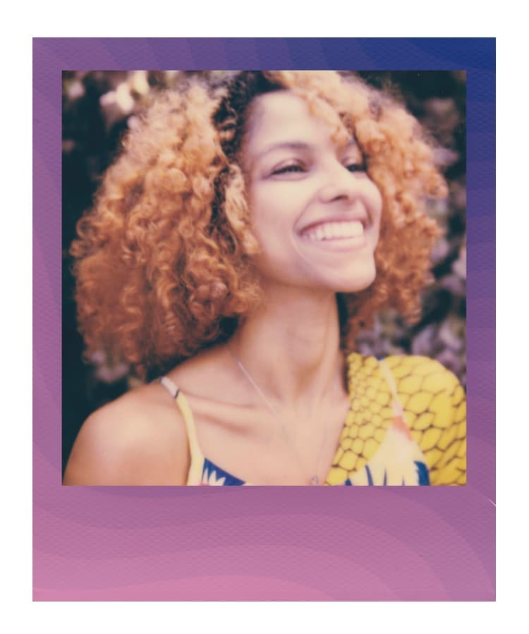 Polaroid of Smiling Girl with Curly Hair