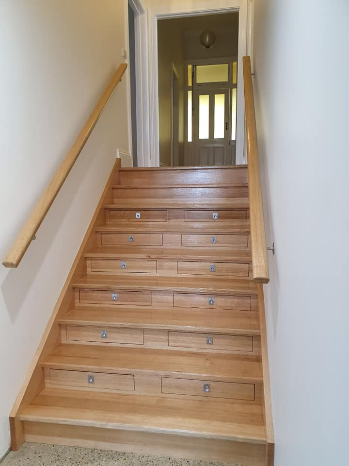 Staircase with Built in Wine Storage