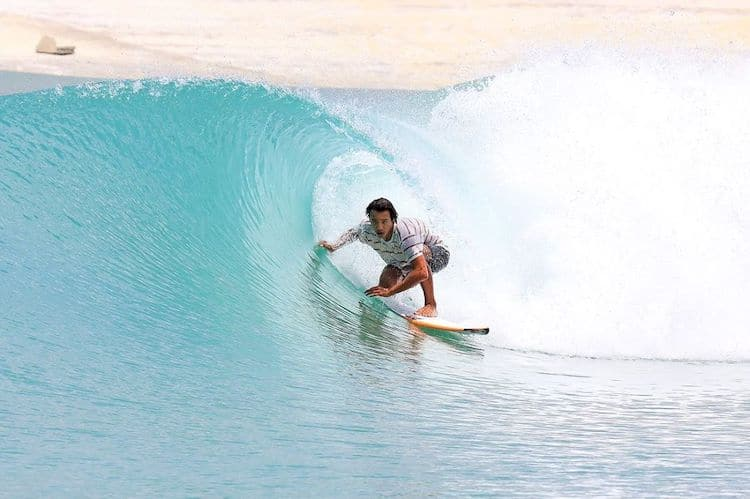 Professional Surfer Going Through a Barrel at Surf Lakes Wave Pool