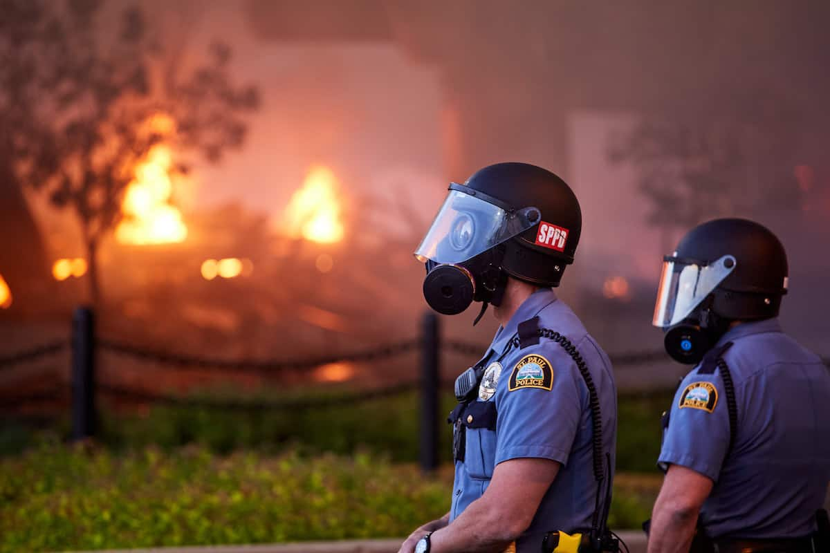 St. Paul Police Officers with Burning Building During George Floyd Protests