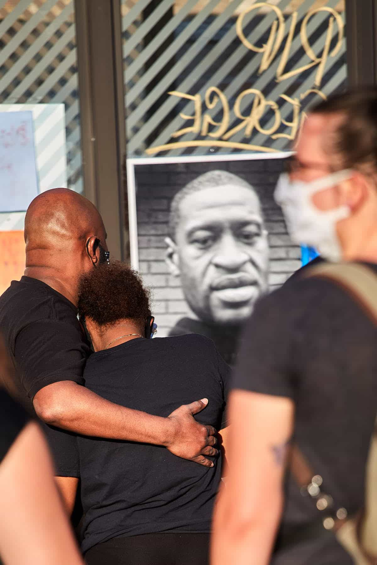 People Comforting Each Other at George Floyd Memorial in Minneapolis