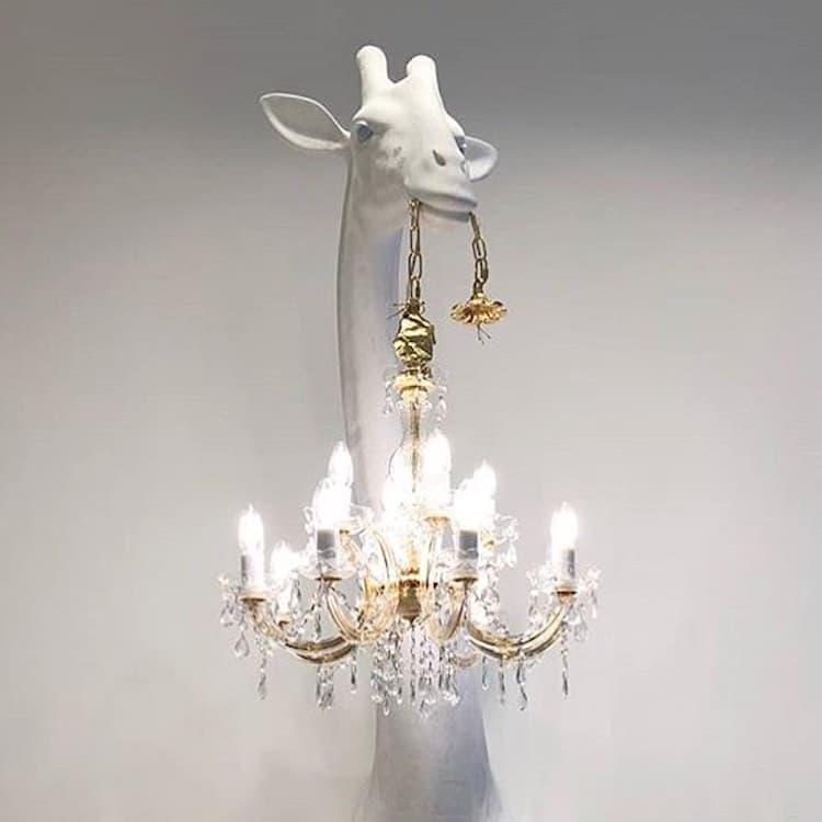 escultura de jirafa con candelabro por Marcantonio