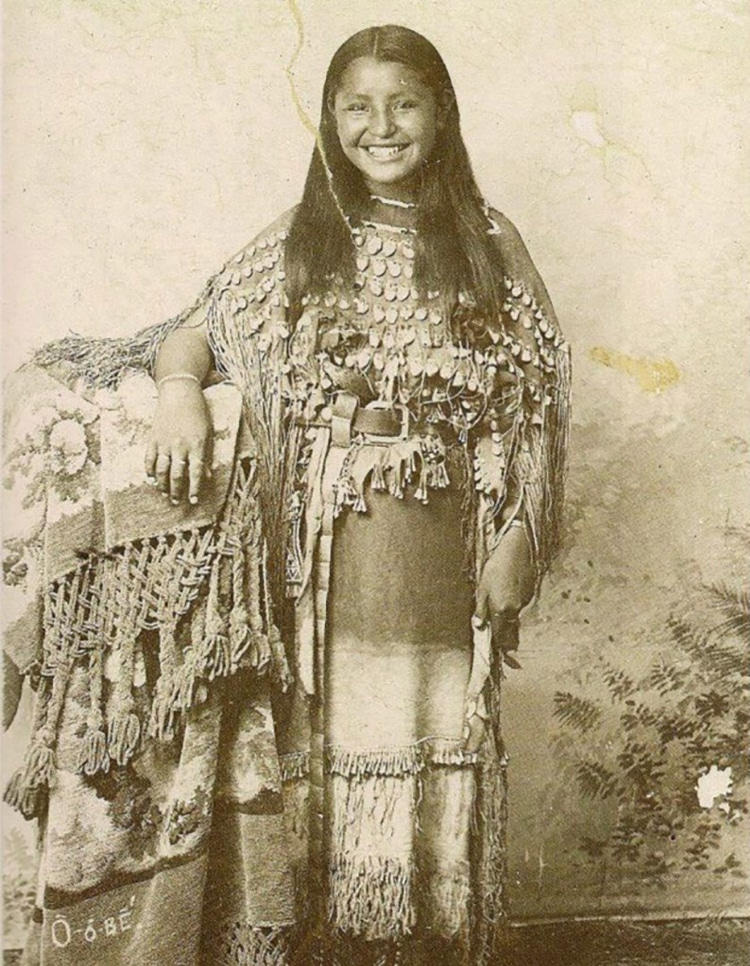 Photograph from 1894 of a smiling young Kiowa woman named O-o-dee
