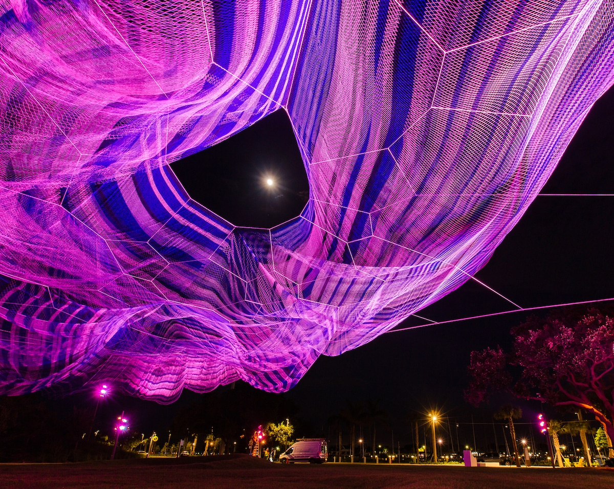 Janet Echelman's Bending Arc Installation Lit Up at Night
