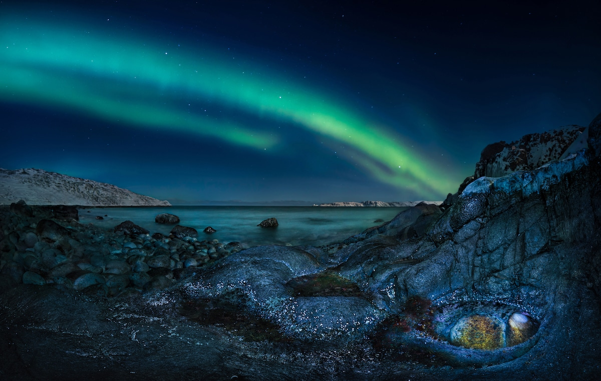 Northern Lights Above Rocky Surface