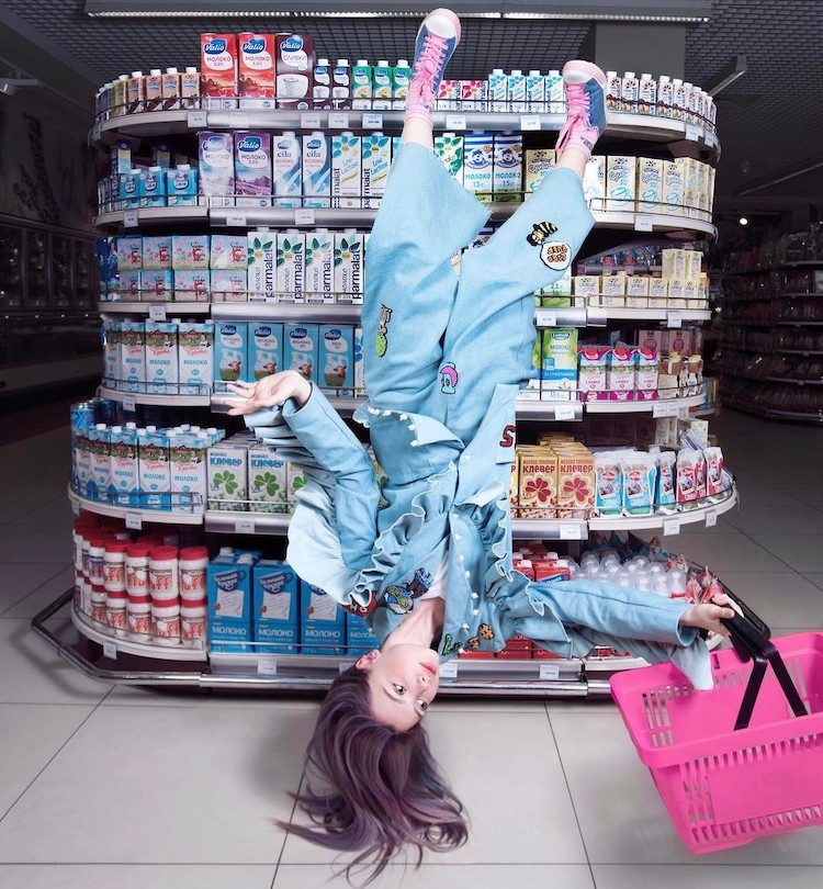 Woman Upside Down in Front of Products