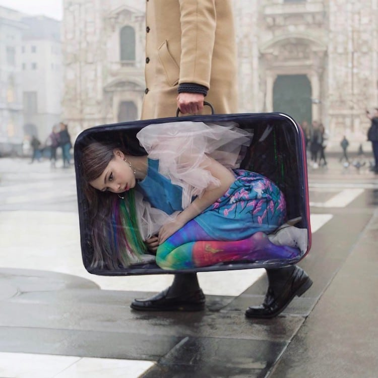 Surreal Photo of Girl Being Carried in a Suitcase