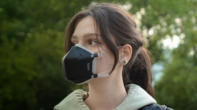Woman Wearing a Black Reusable Face Mask