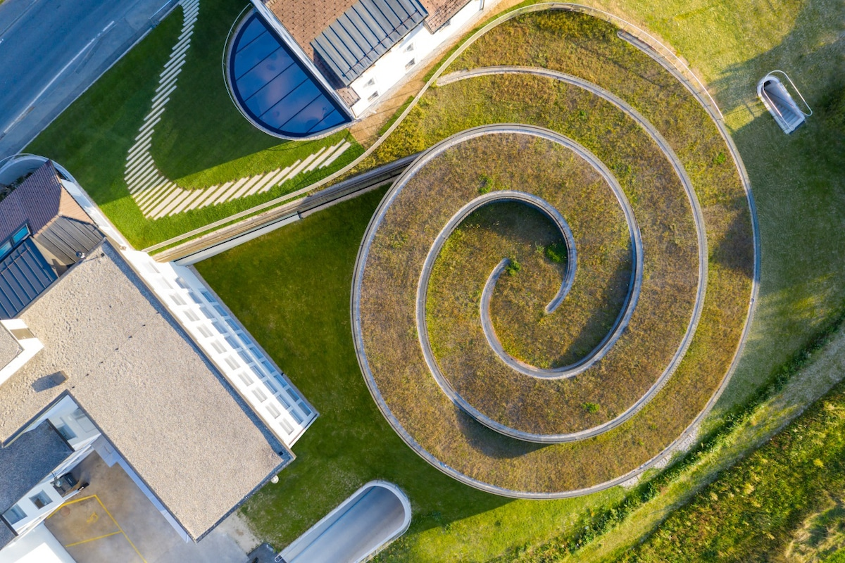 Aerial View of Grass Roof at the Musée Atelier Audemars Piguet by Bjarke Ingels Group