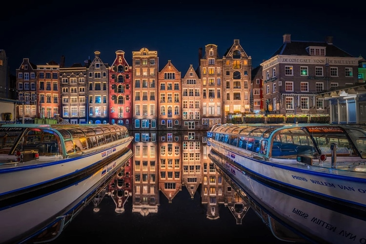 Buildings Along Amsterdam Canal at Night