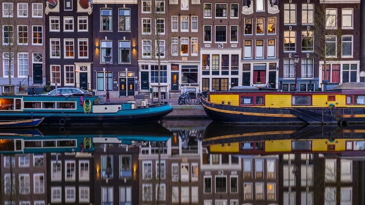 Boats and Architecture Reflecting in the Water in Amsterdam