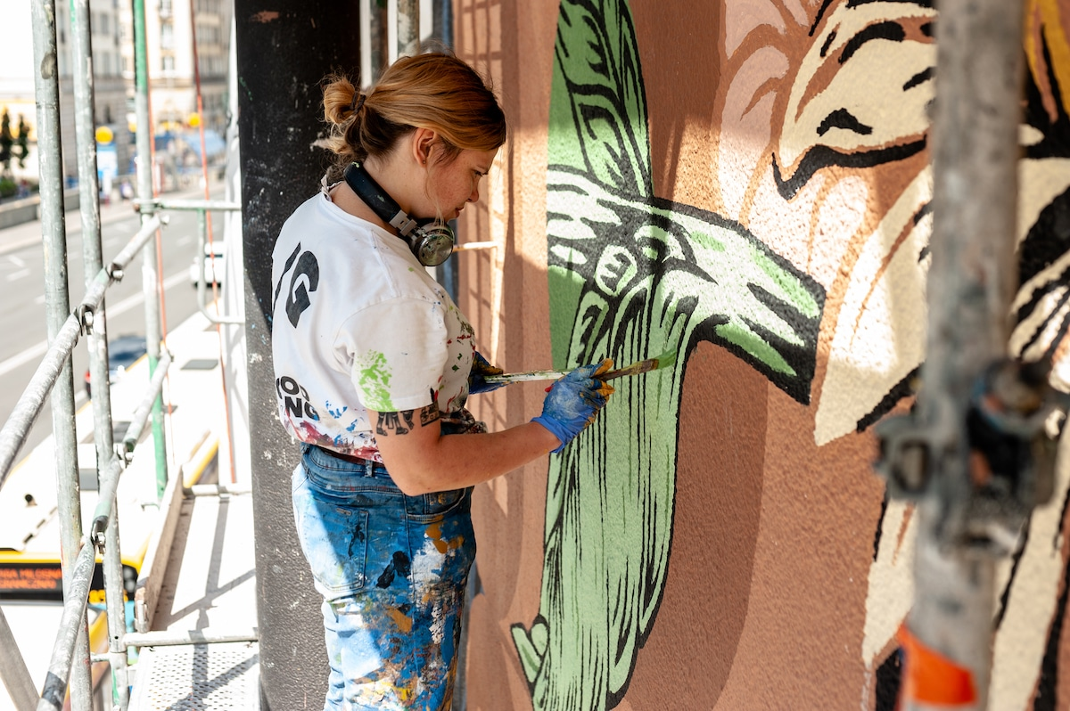 Artist Painting an Environmentally Friendly Mural