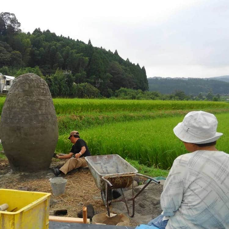 Japanese Grandparents making Totoro statue