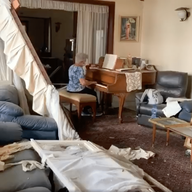 May Abboud Melki playing piano in destroyed home