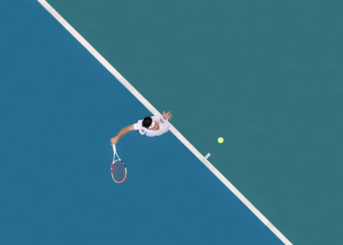 Overhead View of Tennis Playing Serving