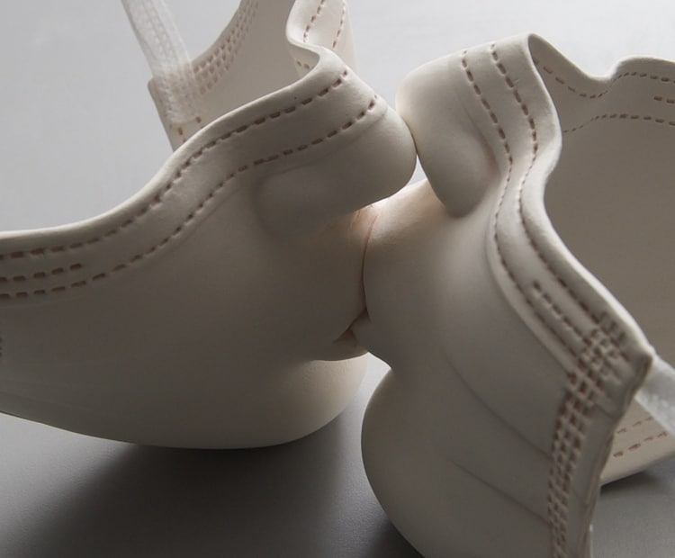 Detail of Ceramic Face Mask Sculpture by Johnson Tsang