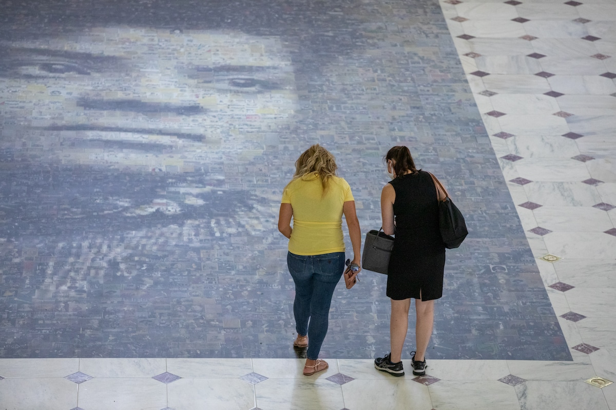 Women Looking at Ida B. Wells Mosaic