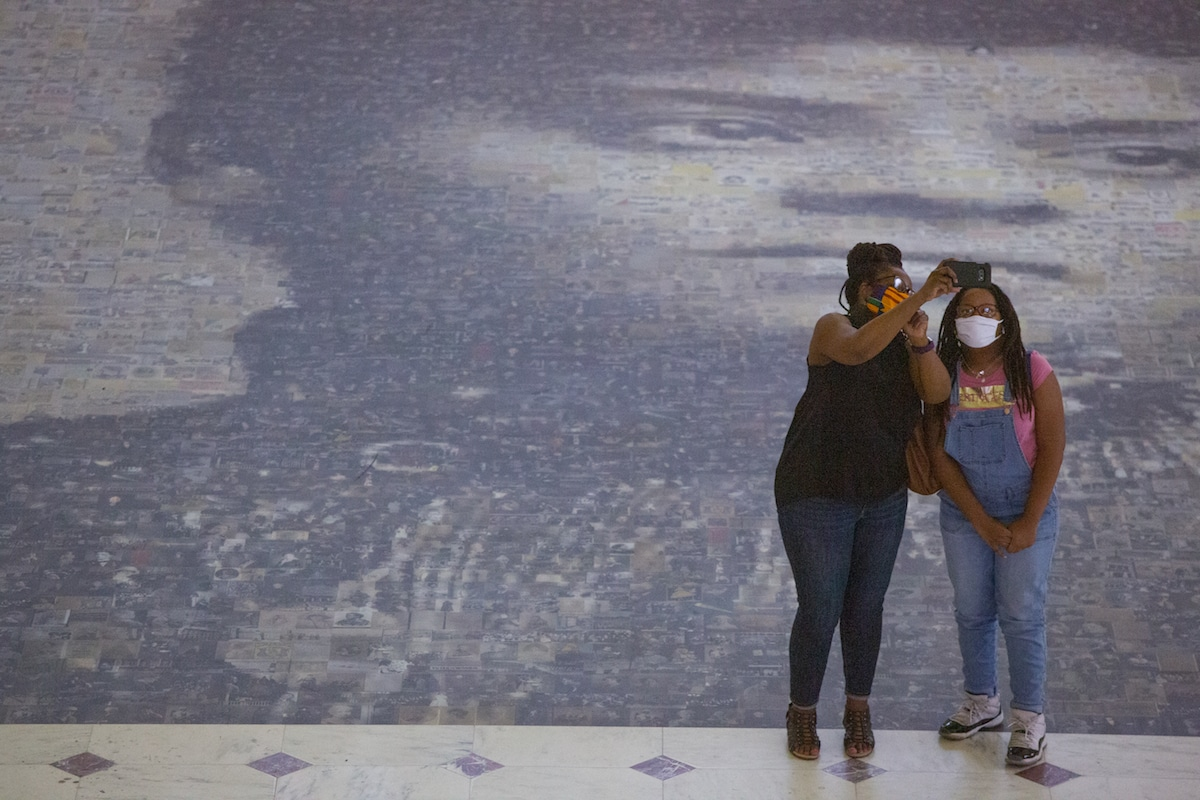 Women taking a selfie at Ida B. Wells Mosaic at Union Station in Washington DC