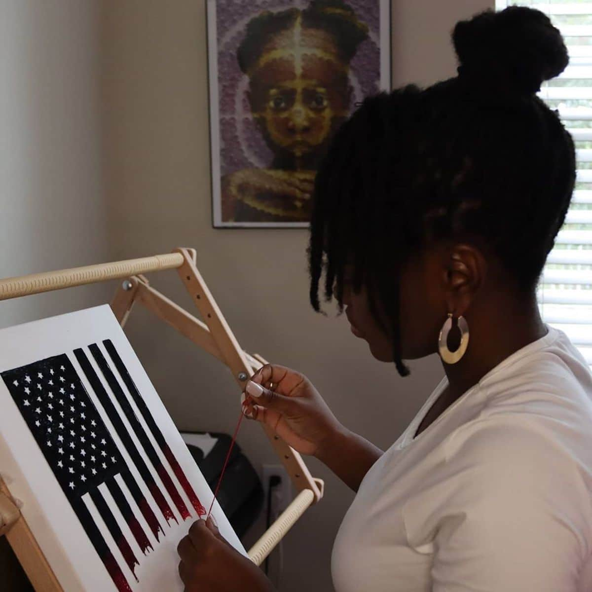 Nneka Jones Embroidering the U.S. Flag