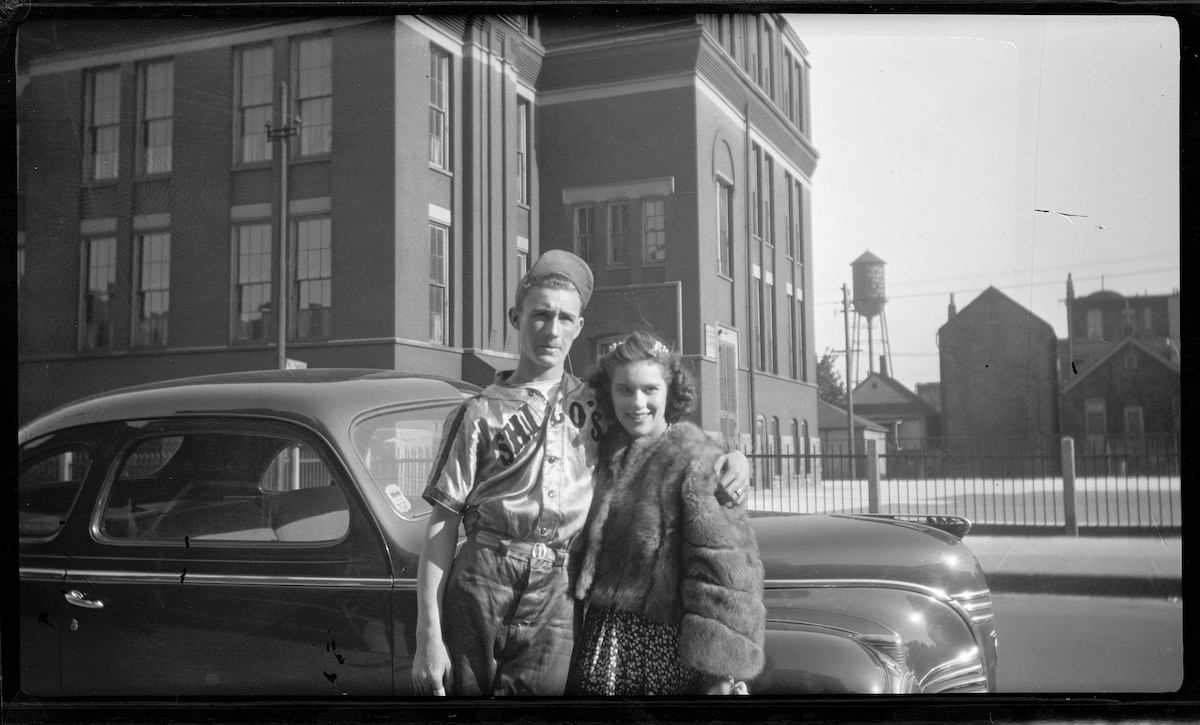 Old Photo of a Couple Posing in Front of a Car in Chicago