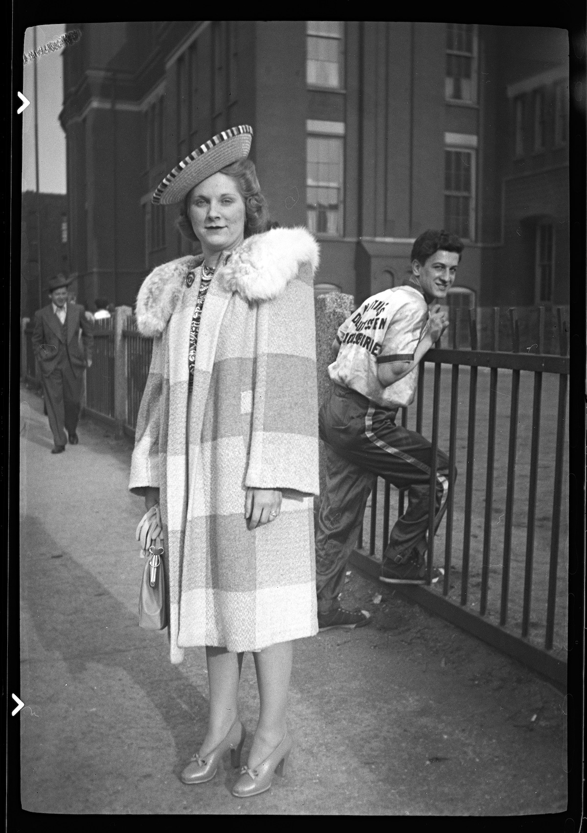Woman in Elegant Vintage Clothes Posing on the Street