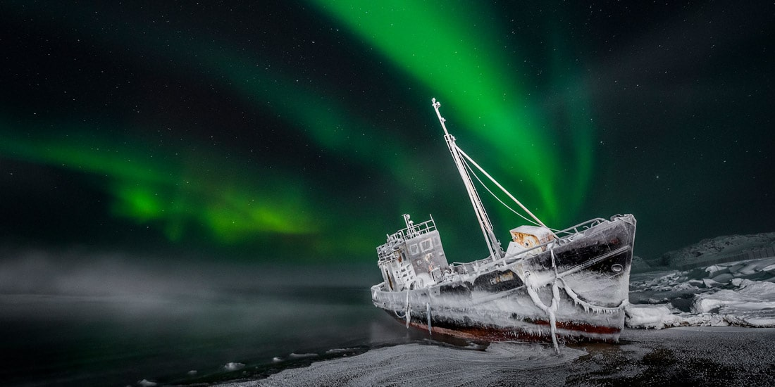 Northern Lights with Snow Covered Ship in Russia