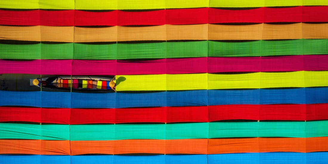Gathering Colorful Fabric on Inle Lake in Myanmar