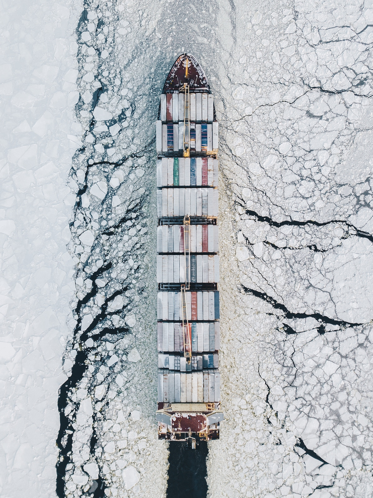 Ship Carrying Freight Through Icy Waters of Finland