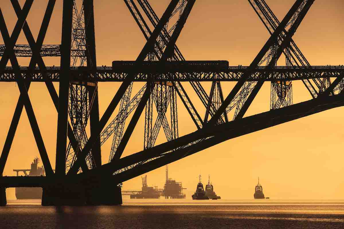 Steel Bridge at Sunset with Boats Crossing