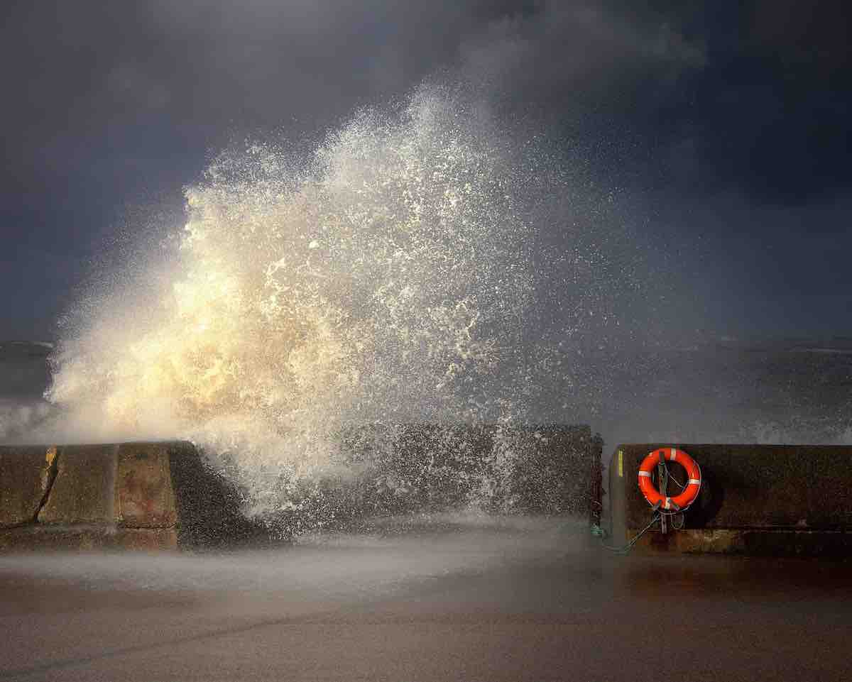 Waves Crashing Into Cement Barriers