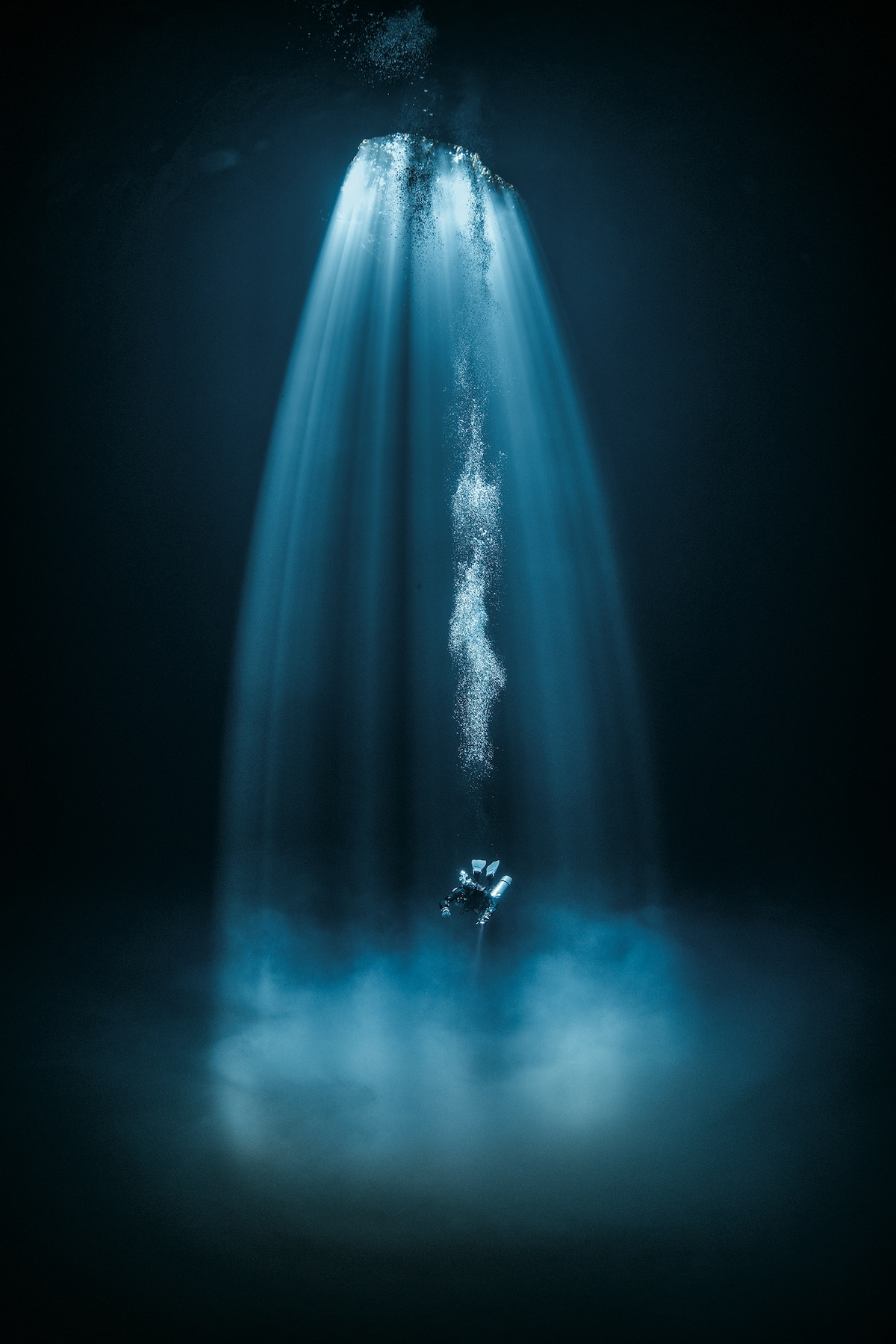 Scuba Diver Underwater Bathed in Light