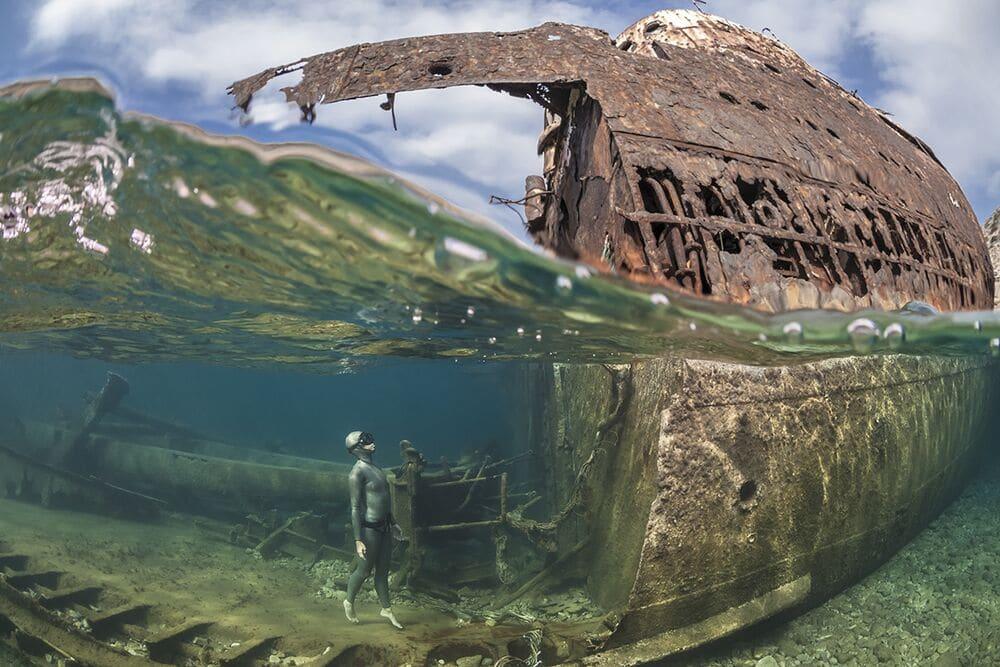 Diver Looking at a Shipwreck