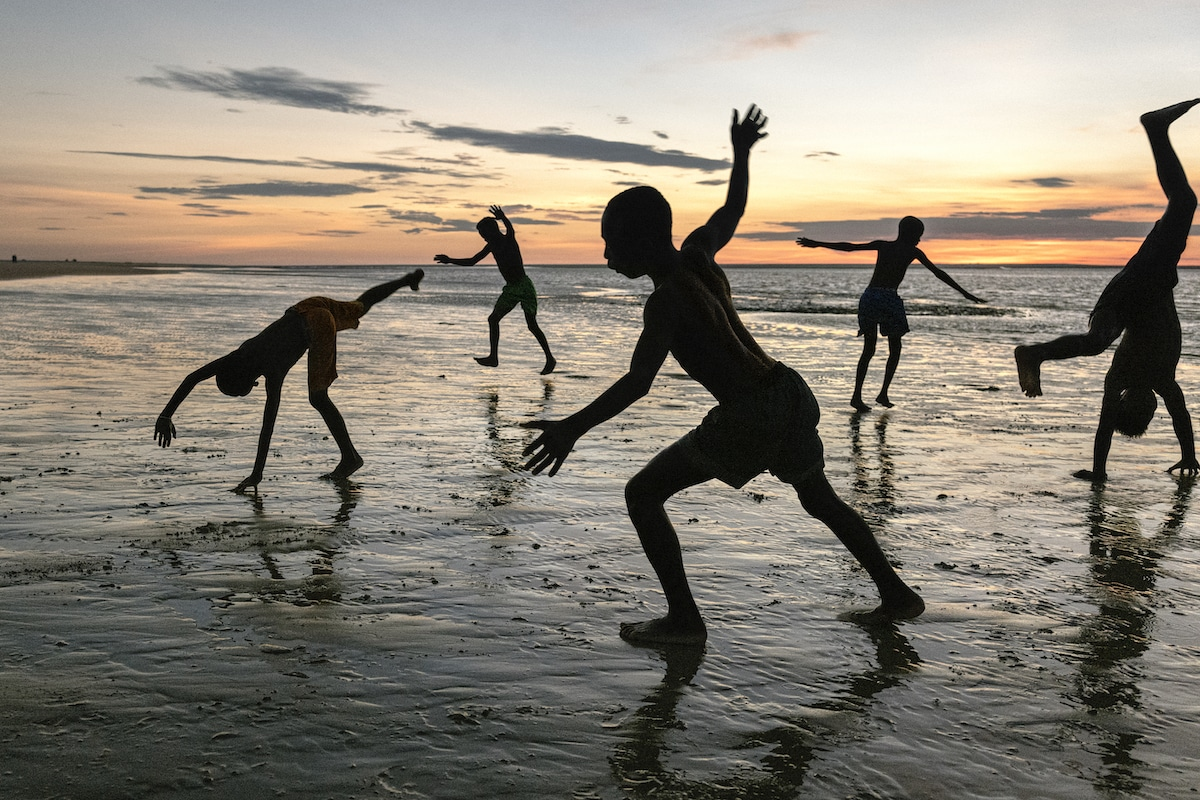 Children Doing Cartwheels on the Beach in Madagascar by Steve McCurry